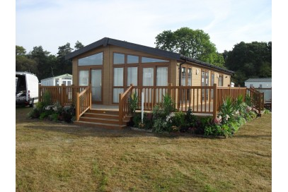 This One is Now Sold but we can get you another one..... Brand New Pemberton Rivendale 40x20 with decking on 12 month holiday plot at Poolview Park